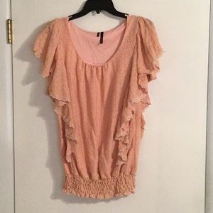 Peach colored ruffled top